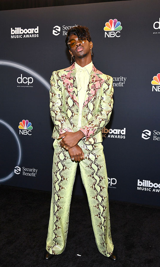 <a href=/tags/0/Lil-nas-x><strong>Lil Nas X</strong></a> embraced a fun look in a pistachio green snake print suit with pink accents.
