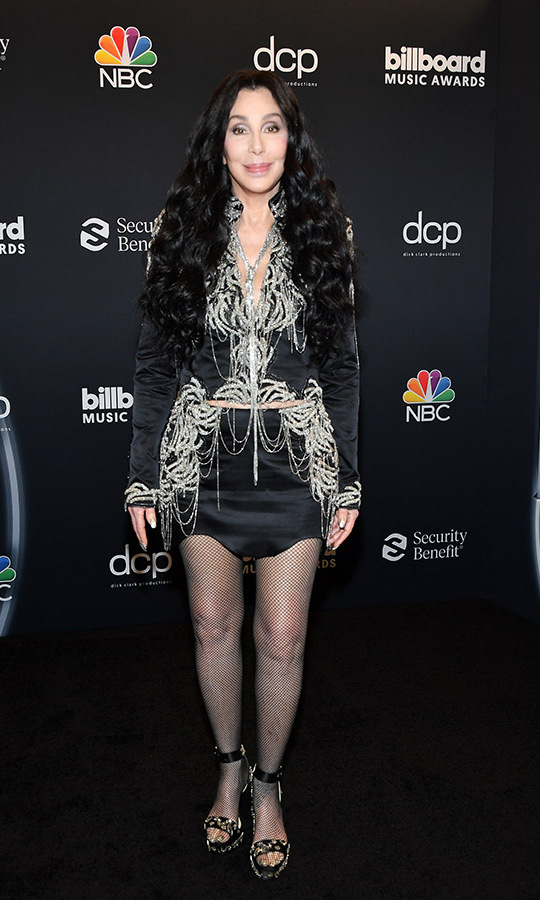 Can you believe <a href=/tags/0/cher><strong>Cher</strong></a> is 74?! The legend looked sensational in black coordinates embellished with draped glittering fringe.