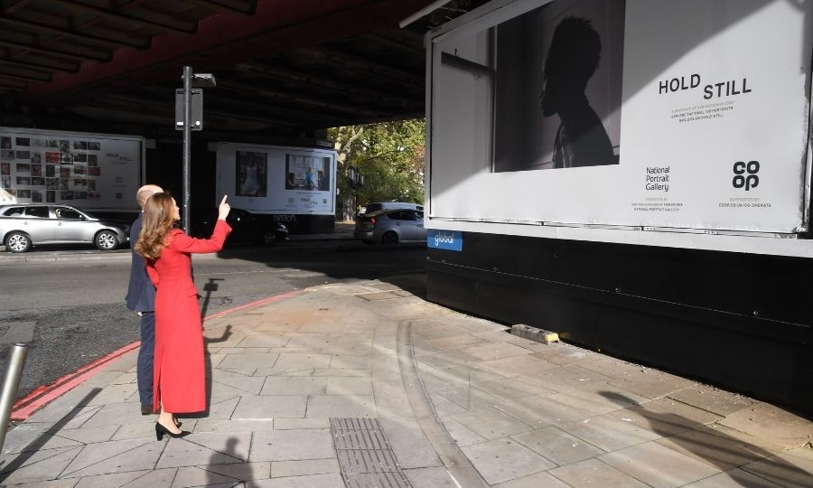 "Kate and William also took in a billboard of one of the 100 images chosen as finalists in the competition. It's <Strong>Lotti Sofia</strong>'s <a href=https://www.npg.org.uk/hold-still/images/the-look-of-lockdown/>""London.""</a> It shows Lotti's friend <strong>Pepter</strong> looking out a window during lockdown. 