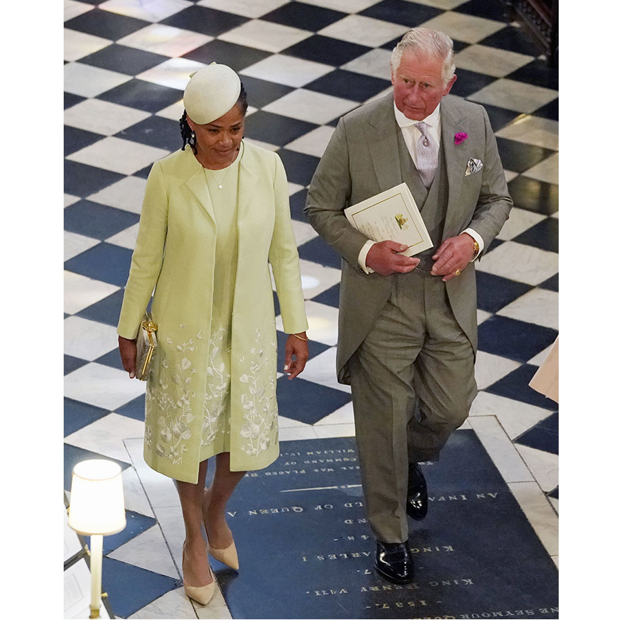 In the interview, Charles (pictured with Duchess Meghan's mother, Doria) discussed the suit he wore to the Duke and Duchess of Sussex's 2018 royal wedding. The look from Anderson & Sheppard dates from 1984. Photo: © OWEN HUMPHREYS/AFP via Getty Images