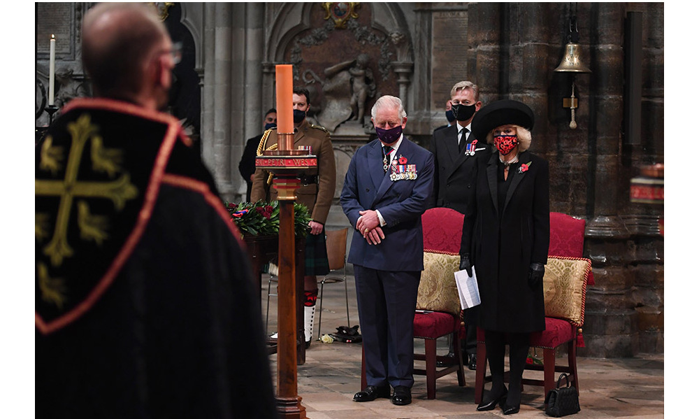 The Prince of Wales and Duchess Camilla participate in a service to commemorate the centenary of the burial of the Unknown Warrior at Westminster Abbey on Armistice Day on Nov. 11, 2020.