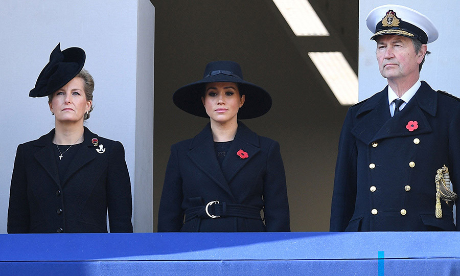 The Countess of Wessex, Duchess Meghan and a href=/tags/0/timothy-laurence><strong>Timothy Laurence</strong></a>, <a href=/tags/0/princess-anne><strong>Princess Anne</strong></a>'s husband, take in the 2019 Remembrance Day service from another balcony.