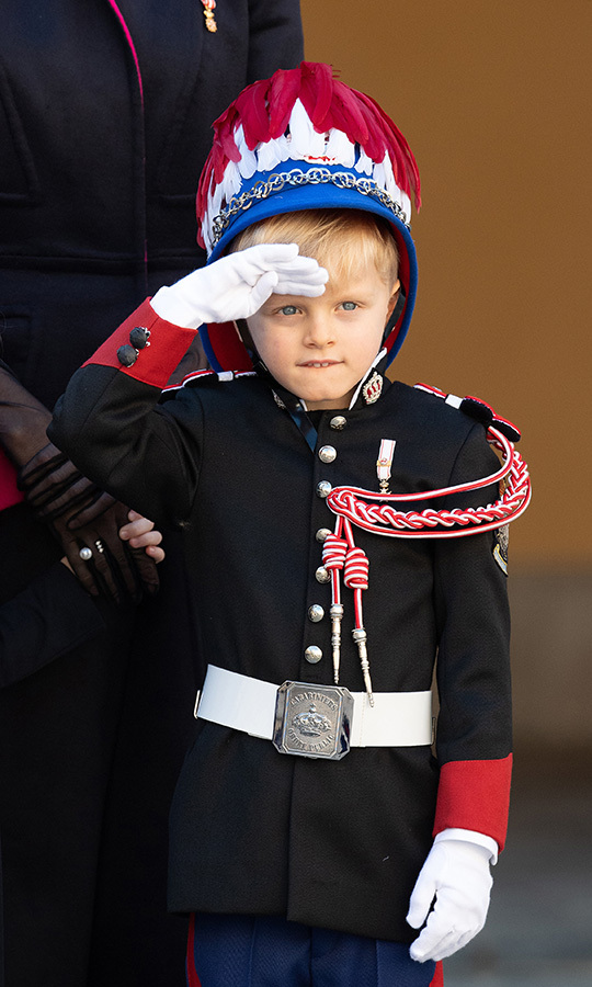 The young royal gave a sharp salute of his own while dressed in uniform.