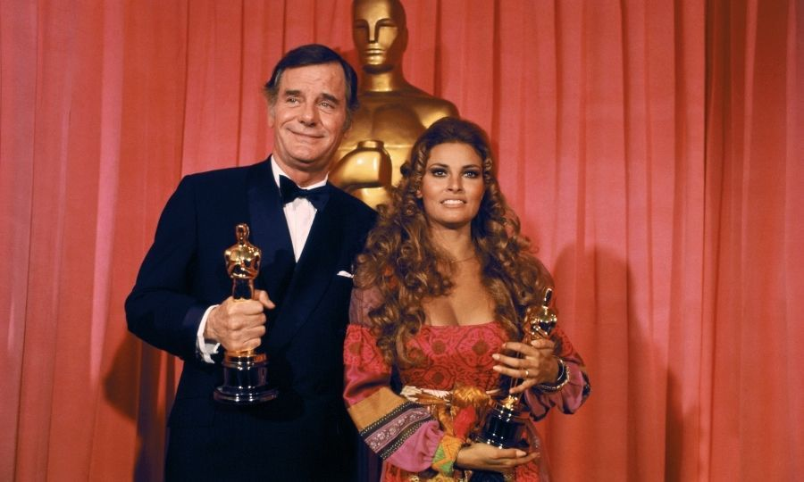In 1970, at 23, Goldie won an Oscar for <i>Cactus Flower</i> with <strong>Walter Matthau</strong> and <strong>Ingrid Bergman</strong>. Goldie was in London filming with <strong>Peter Sellers</strong>, so <strong>Raquel Welch</strong> (right, with best supporting actor <strong>Gig Young</strong>) accepted on her behalf.