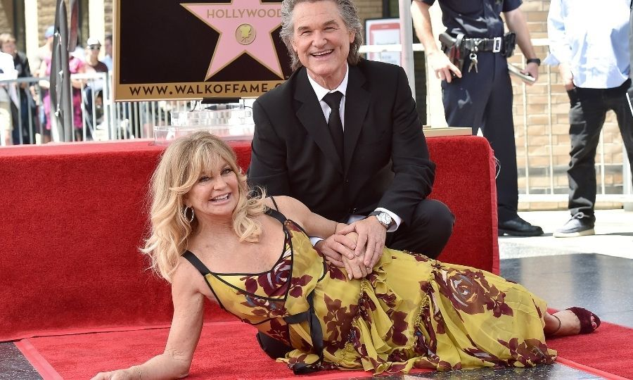 After 37 years, Goldie and Kurt continue to delight one another, both at work and at play. They're seen left at their double star Hollywood Walk of Fame ceremony in 2017. 