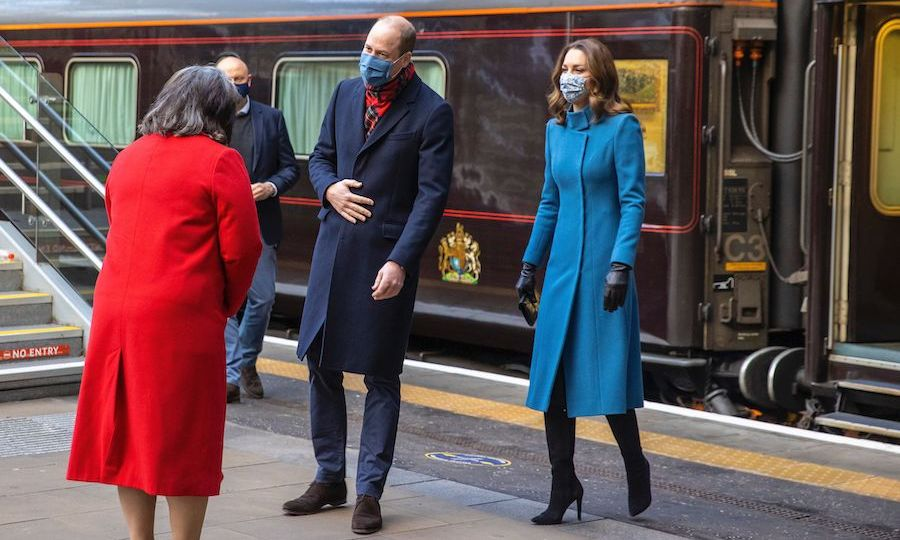 The duke and duchess arrived in Edinburgh on the morning of Dec. 7 and looked refreshed. Kate looked bright and happy in a powder blue <strong><a href=/tags/0/catherine-walker>Catherine Walker</a></strong> coat and black gloves. William was again in his dark blue overcoat, which he paired with a tartan scarf. 
