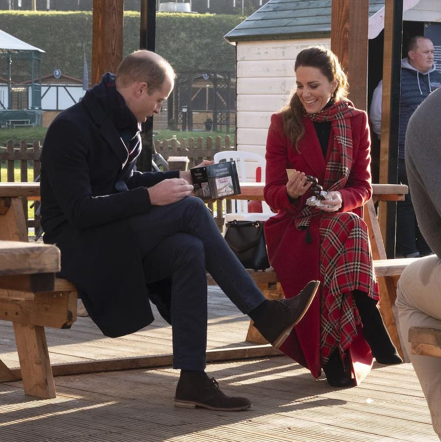 "The Cambridges also participated in a ""Secret Santa"" gift giving exchange. Kate received a traditional Welsh love spoon and William got a Guiness beer mat flipping game. 