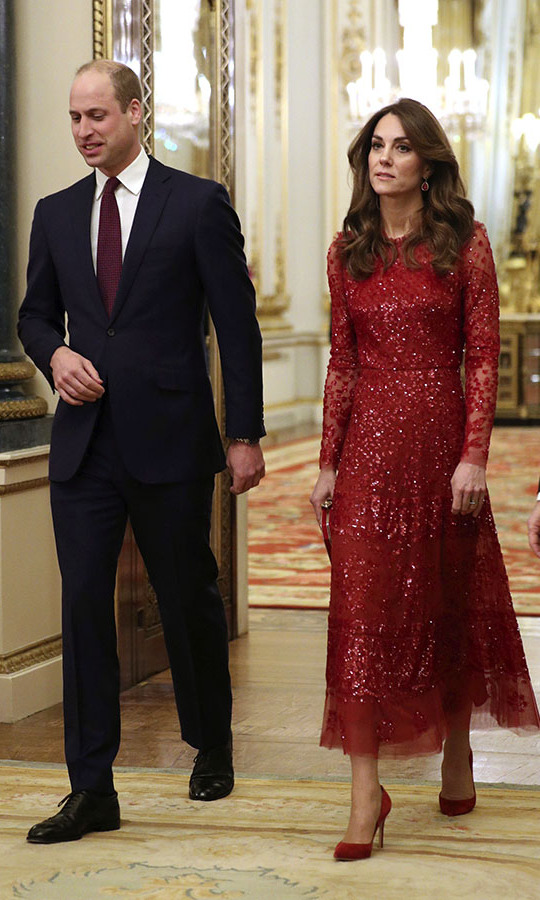 On Jan. 20, <a href=/tags/0/kate-middleton><strong>Duchess Kate</strong></a> and <a href=/tags/0/prince-william><strong>Prince William</strong></a> hosted a reception at Buckingham Palace on behalf of the Queen for the UK-Africa Investment Summit. The duchess was a vision in a twinkling <strong>Needle & Thread</strong> dress with coordinating <a href=/tags/0/gianvito-rossi><strong>Gianvito Rossi</strong></a> heels, clutch and <strong>Soru</strong> ruby earrings. <p>Photo: © YUI MOK/POOL/AFP via Getty Images