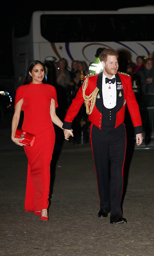 "Duchess Meghan looked sensational in head-to-toe red when she and Prince Harry attended the Mountbatten Festival of Music at Royal Albert Hall on March 7. She was outfitted in a <strong>Safiyaa</strong> short-sleeved gown, burgundy floral earrings by <strong>Simone Rocha</strong>, a <a href=""https://ca.hellomagazine.com/tags/0/manolo-blahnik""><strong>Manolo Blahnik</strong></a> clutch and <strong><a href=""https://ca.hellomagazine.com/tags/0/aquazzura"">Aquazzura</a></strong> heels.