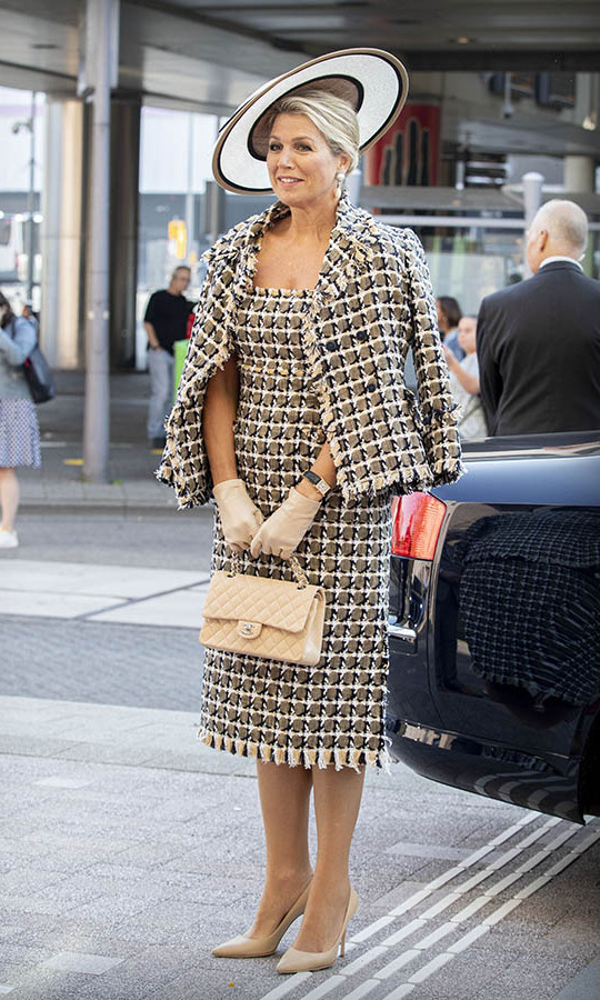 Máxima made a statement in a beige, cream and black tweed dress and jacket for the opening of Theater Zuidplein on Sept. 16 in Rotterdam.