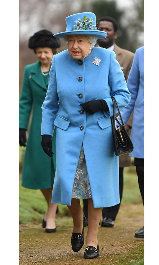 On Feb. 2, <a href=/tags/0/queen-elizabeth-ii><strong>Her Majesty</strong></a> captivated in a blue coat and coordinating hat and paisley dress when she arrived for Sunday service at St. Peter and St. Paul church in West Newton, Norfolk.<p>Photo: &copy; Joe Giddens/PA Images via Getty Images