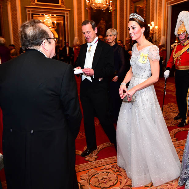 Kate turned heads in a breathtaking embellished Jenny Packham gown, her Royal Order and glitzy accessories. 