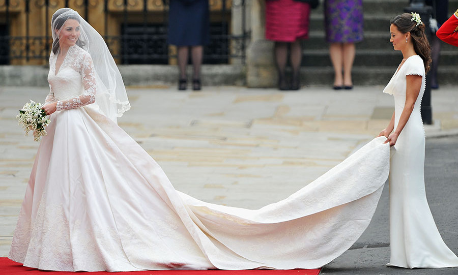 <p>The Duchess of Cambridge's bridal look was completed with a bespoke <a href=/tags/0/alexander-mcqueen><strong>Alexander McQueen</strong></a> lace wedding gown and custom <strong>Robinson Pelham</strong> diamond earrings.