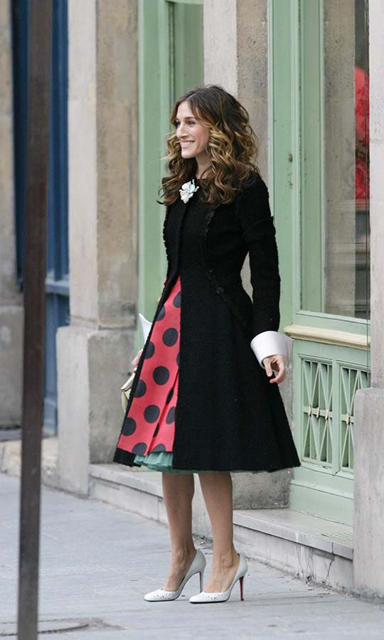 Seeing spots! When Sarah took her character Carrie on a Paris fantasy, it was made all the more memorable thanks to her character's bold fashion choices in the fashion capital, including this Victorian-inspired black coat and polka dot skirt. 