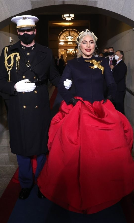 Lady Gaga arrived on stage wearing a gorgeous red, white and blue ensemble, capped off by a golden eagle brooch. 