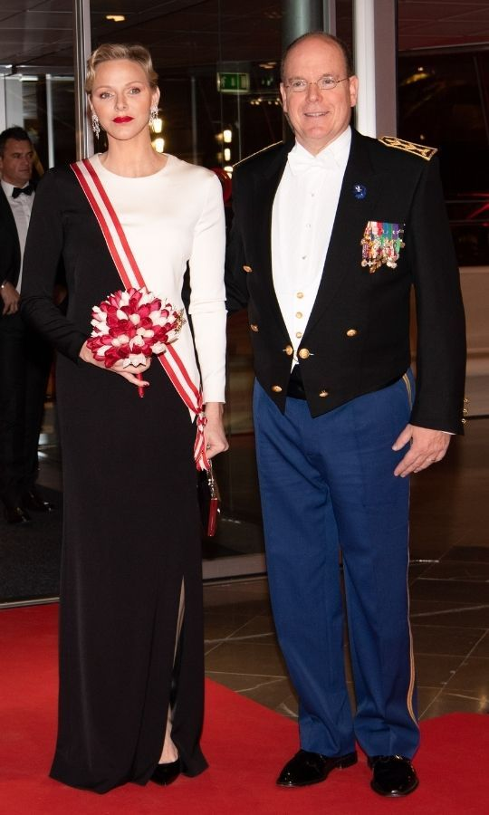 Charlene looked so elegant in a beautiful navy and white gown paired with a red and white sash on Monaco's National Day in 2018. 