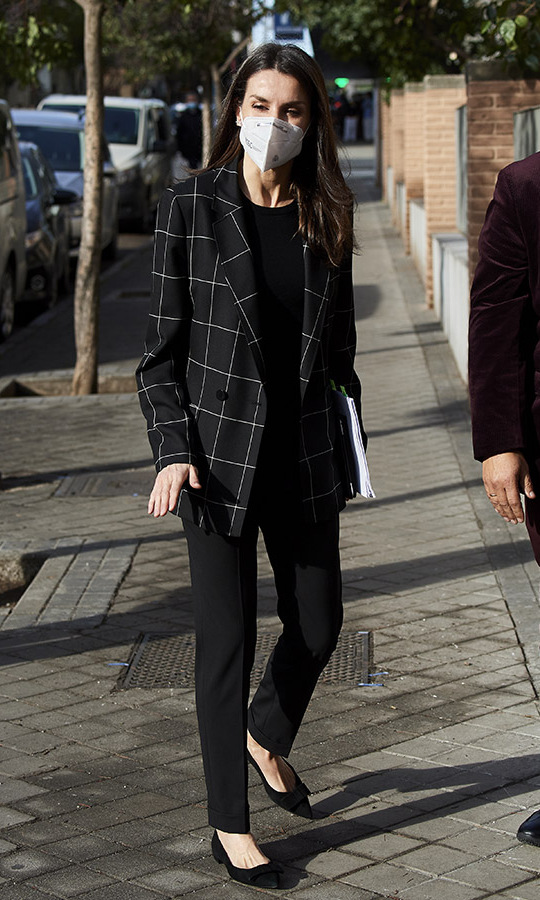On Jan. 27, <a href=/tags/0/queen-letizia><strong>Queen Letizia</strong></a> showcased another sleek suit from her wardrobe. She wore a black windowpane jacket with slim trousers and flats for a meeting at FEDER (Spanish Federation for Rare Diseases) in Madrid. 