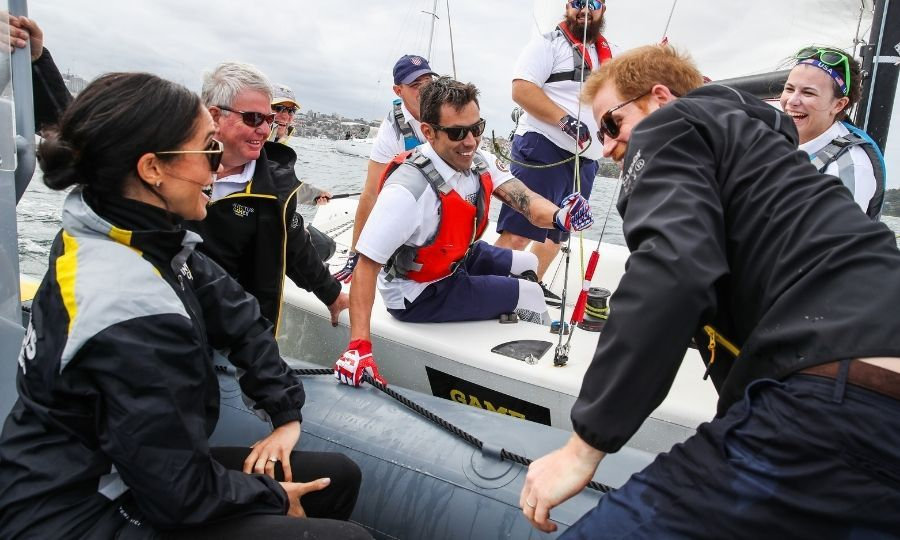 Meghan and Harry speak to sailors during the 2018 Invictus Games in Sydney, Australia. Photo: © Chris Jackson/Getty Images for the Invictus Games Foundation