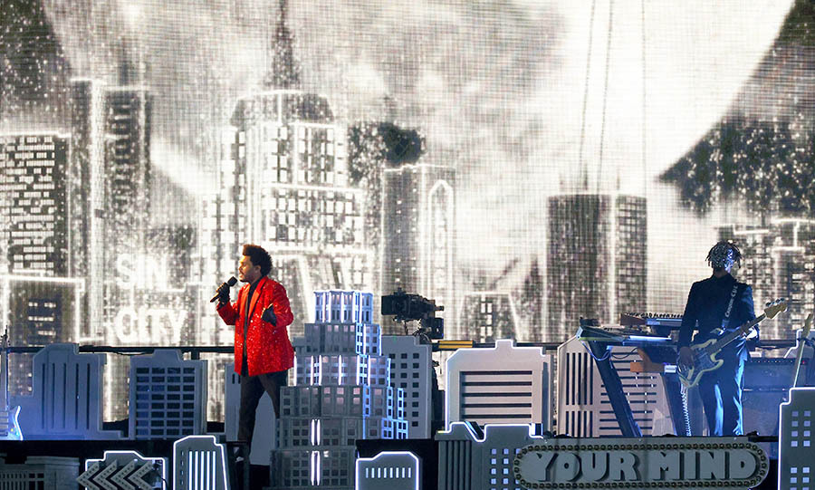 "The Weeknd moved into ""I Feel It Coming"" in front of a dramatic moon background.