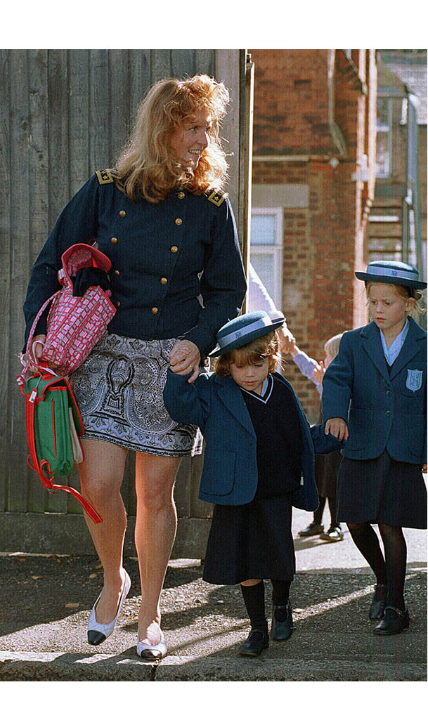 First day of school! Sarah, Duchess of York and Beatrice held Eugenie's hands on her first day of school at Upton House School in September 1994.