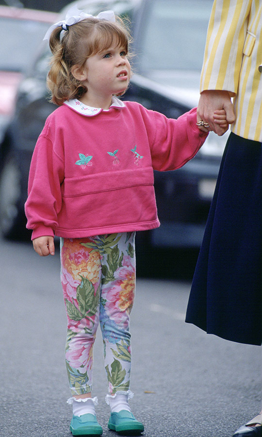 In June 1994, the Princess of York looked adorable in a classic '90s kid ensemble of patterned leggings and a bright top for Sports Day at Upton House School.