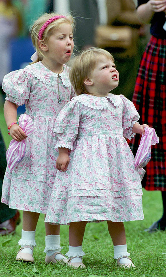 Two-year-old Eugenie and big sister <a href=/tags/0/princess-beatrice><strong>Princess Beatrice</strong></a> had fun at The Royal Windsor Horse Show on May 15, 1992.