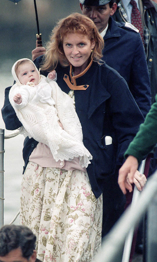 Sarah held a little Eugenie as they left The Castle of Mey, to board the <em>Royal Yacht Britannia</em> after visiting the <a href=/tags/0/queen-mother><strong>Queen Mother</strong></a> on Aug. 12, 1990 in Thurso, Scotland. 