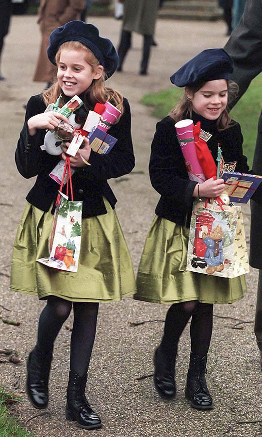 Princess Beatrice and Princess Eugenie had their arms laden with gifts as they attended <a href=/tags/0/christmas><strong>Christmas</strong></a> Day service at <a href=/tags/0/sandringham><strong>Sandringham</strong></a> in 1997.