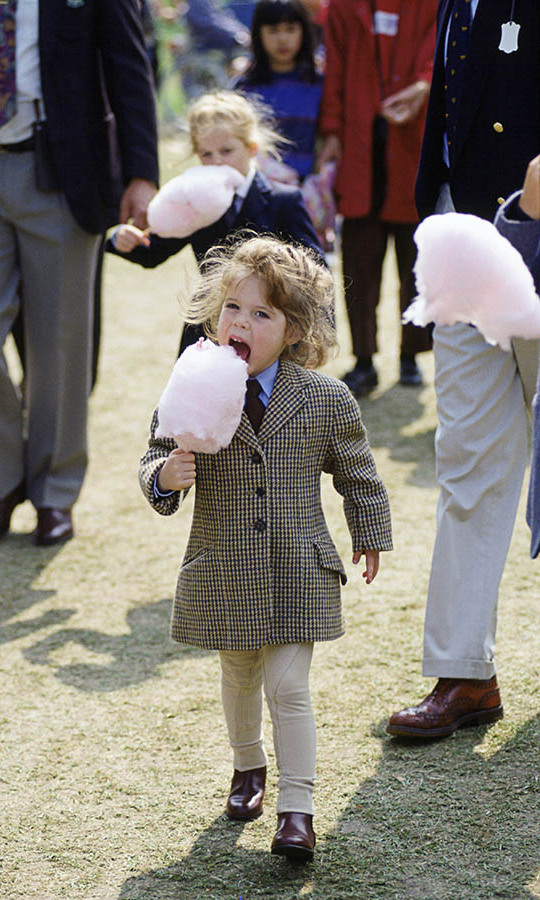 Yum! The princess and her sister Beatrice (behind) enjoyed candy floss at The Royal Windsor Horse Show in May 1994.