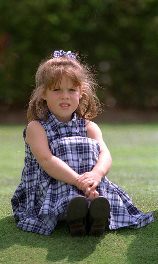 The six-year-old looked in thought as she watched a golf game at Wentworth.