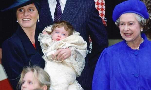 Eugenie was photographed with mom <a href=/tags/0/sarah-ferguson><strong>Sarah Ferguson</strong></a> and grandmother <a href=/tags/0/queen-elizabeth-ii><strong>the Queen</strong></a> during her christening in December 1990. 