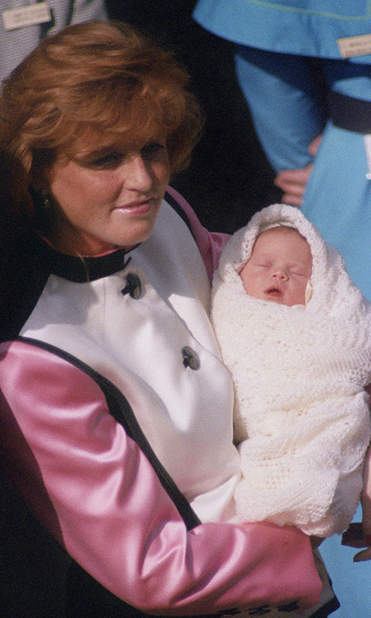 Sarah, Duchess of York is seen leaving the Portland Hospital in London with her new daughter on March 30, 1990.