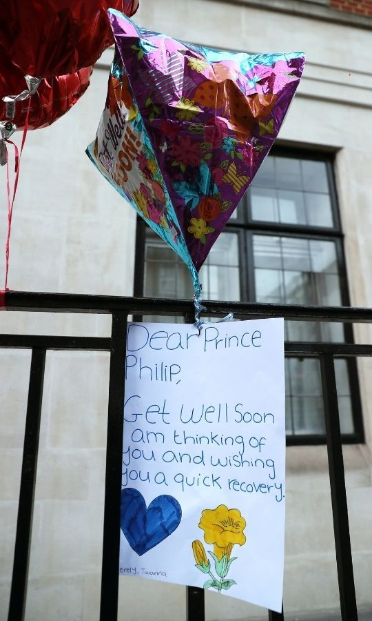 Balloons with a get well soon message for Prince Philip are seen outside London's King Edward VII hospital on Feb. 22. Photo: © Chris Jackson/Getty Images