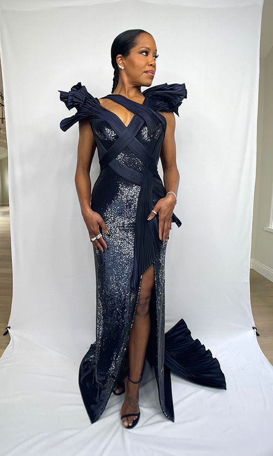 <a href=/tags/0/regina-king><strong>Regina King</strong></a> slayed at the awards in a navy <a href=/tags/0/versace><strong>Versace</strong></a> gown.