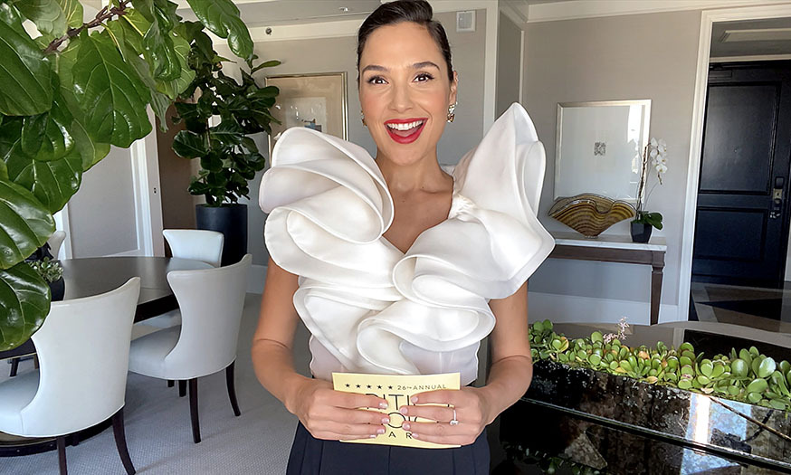 An expectant <a href=/tags/0/gal-gadot><strong>Gal Gadot</strong></a> glowed in a monochromatic ensemble with dramatic frilled top courtesy of <a href=/tags/0/prabal-gurung><strong>Prabal Gurung</strong></a>. 