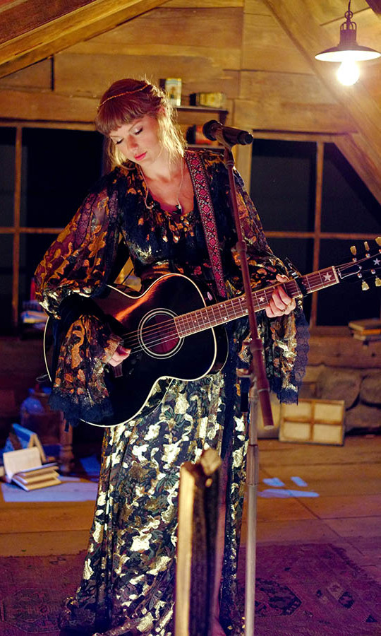 It was pure <em>Folklore</em> magic when <a href=/tags/0/taylor-swift><strong>Taylor Swift</strong></a> emerged with her guitar in a floral maxi gown.