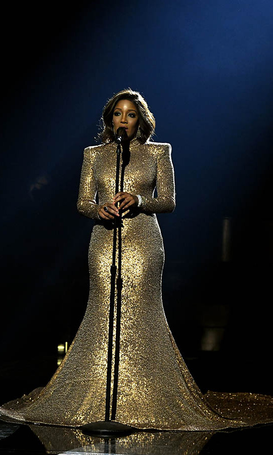"<strong>Mickey Guyton</strong> shone in a glistening gold gown as she belted out ""Black Like Me.""