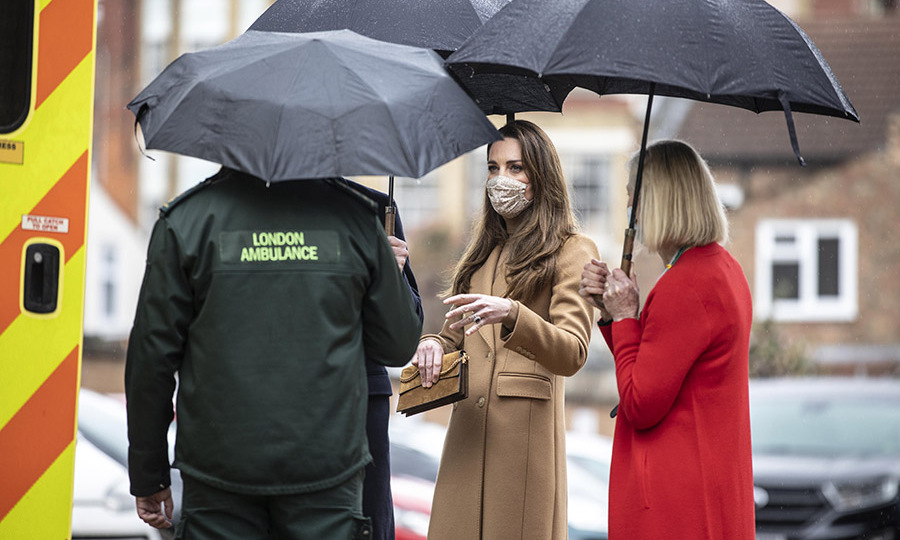 Kate and William (who is just seen next to the duchess) had a conversation with a London Ambulance worker near one of the vehicles.
