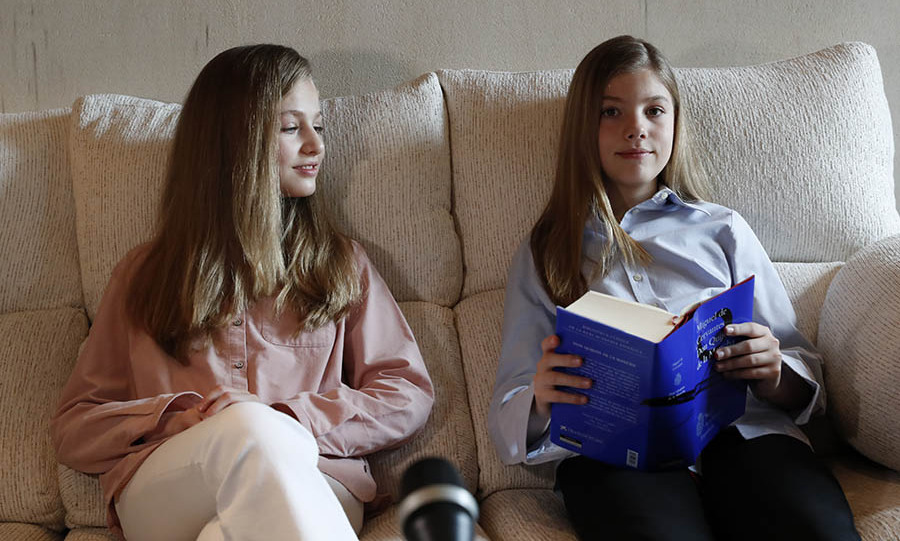Leonor (left) with sister Sofia reading Don Quixote during a continuous reading at Zarzuela Palace in Madrid on April 23, 2020. Photo: © Casa de S.M. el Rey Spanish Royal Household via Getty Images