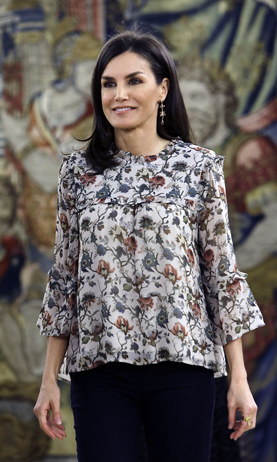 Queen Letizia enhanced her pretty floral blouse with matching earrings during an audience at Zarzuela Palace in February 2020.