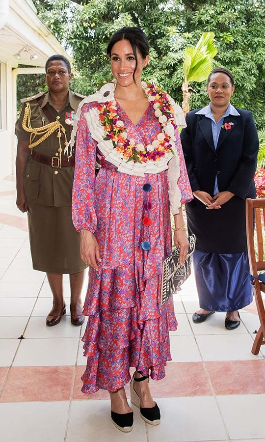 The Duchess of Sussex wowed in a vivid <strong>Figue</strong> floral dress for a morning tea reception at the British High Commissioner's Residence in Suva, Fiji on Oct. 24, 2018. 