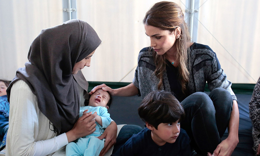 <a href=/tags/0/queen-rania><strong>Queen Rania</strong></a> meet with Syrian refuges at the Kara Tepe municipality camp on the outskirts of Mytilene in Lesbos in 2016. 