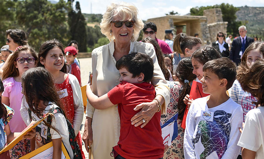 The Duchess of Cornwall received a very warm welcome hug from <strong>Konstantinos Faitakis</strong> at the site.