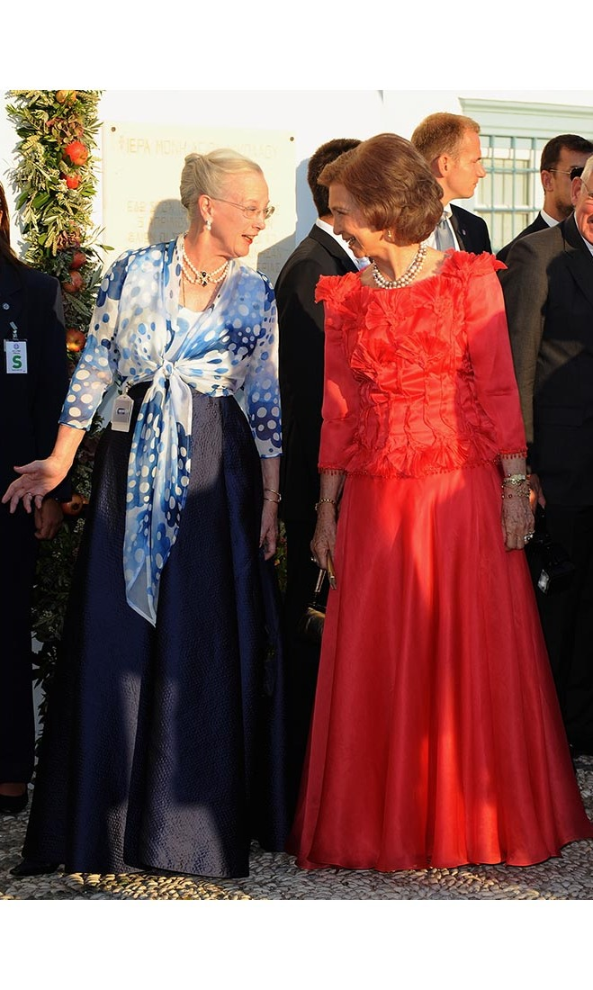 Queen Margrethe and Queen Sofia shared a moment outside of the church at the wedding of Prince Nikolaos and Princess Tatiana.