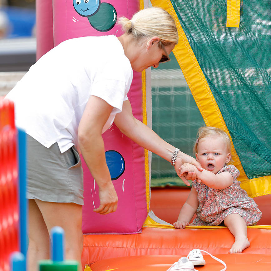 Doting mom Zara helped her youngest daughter out of the bouncy castle at the 2019 Festival of British Eventing in Stroud. It appears something else caught Lena's eye.