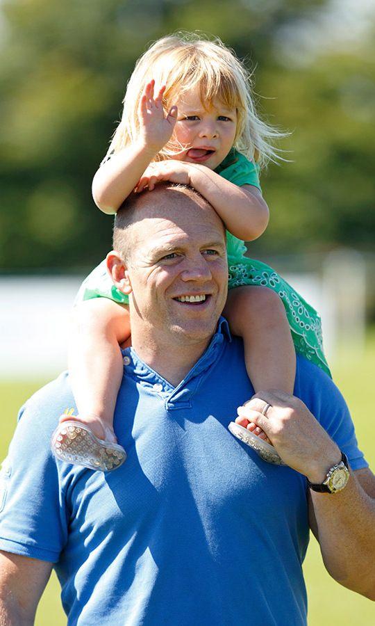 Mia waved from high up on her father's shoulders at the 2016 Festival of British Eventing at Gatcombe Park.