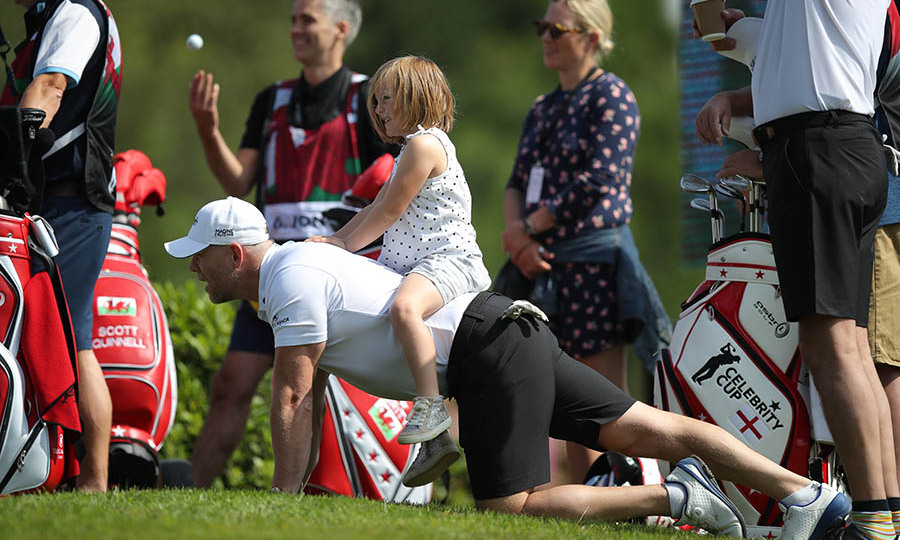 At the Celebrity Cup charity fundraiser golf tournament, Mia looked like she had a blast as she rode on her daddy's back.