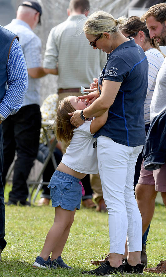Zara playfully touched her elder daughter's face as Mia looked up at her during a day out in Stroud in September 2019. 