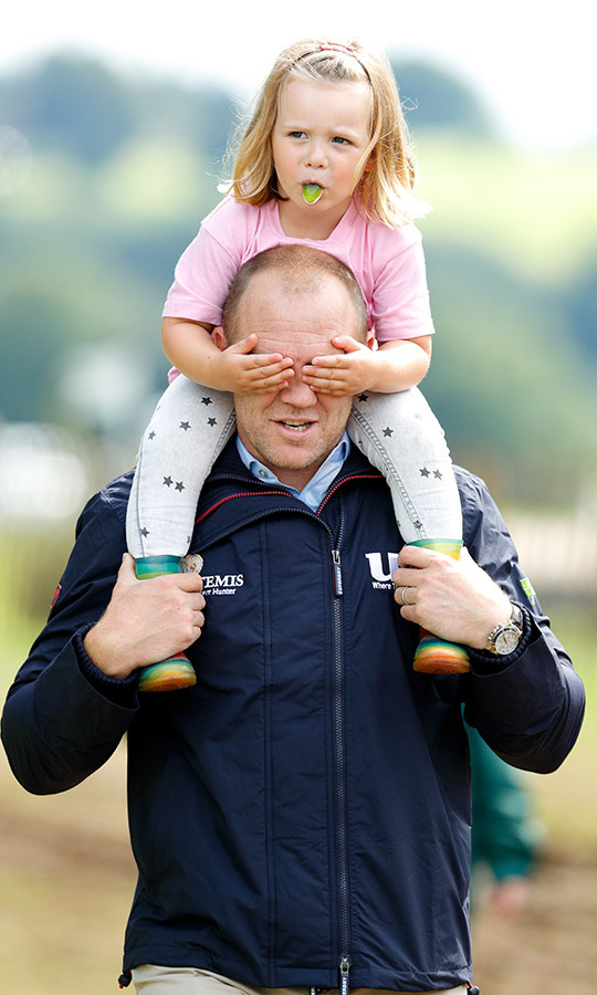 Where did daddy go? Mike carried Mia on his shoulders as they attended the 2017 Festival of British Eventing at Gatcombe Park in Stroud.