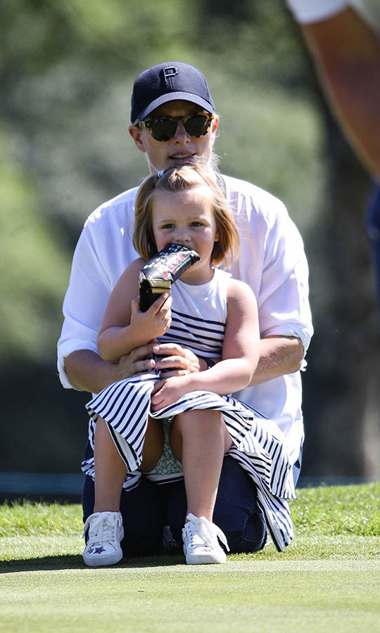 Mia and Zara watched intently during the 2018 Celebrity Cup at Celtic Manor Resort. However, the little girl had something extra to chew on.